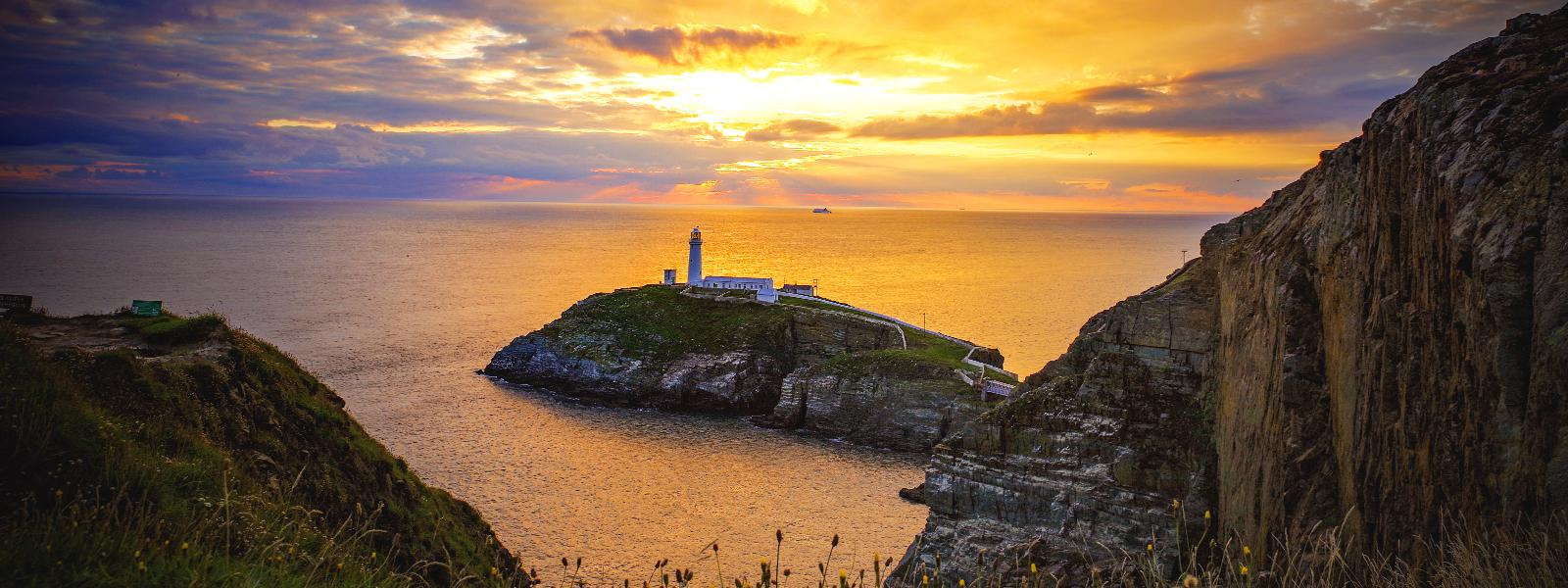 Sunset over South Stack Lighthouse on Holy Island, Anglesey